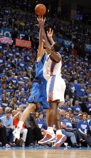 Dirk Nowitzki (41) of Dallas shoots over Oklahoma City's Serge Ibaka (9) during game 3 of the Western Conference Finals of the NBA basketball playoffs between the Dallas Mavericks and the Oklahoma City Thunder at the OKC Arena in downtown Oklahoma City, Saturday, May 21, 2011. Photo by Sarah Phipps, The Oklahoman