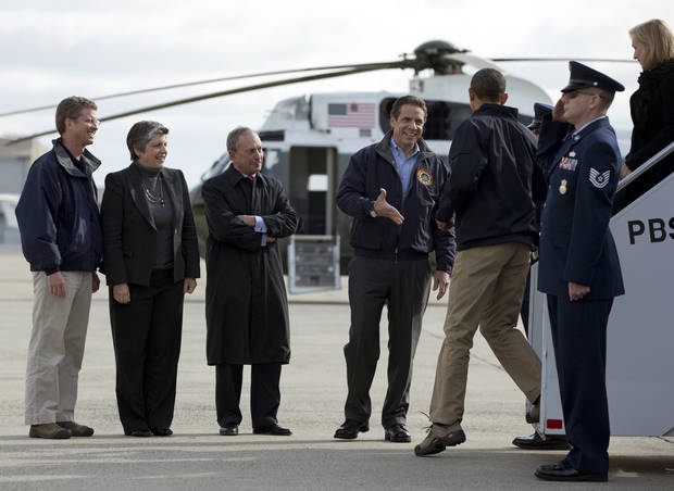 <p>New York Gov. Andrew Cuomo greets President Barack Obama as he arrives at JFK International Airport in New York, Thursday, Nov. 15, 2012, before visiting areas devastated by Superstorm Sandy. From left are, Housing and Urban Development Shaun Donovan, Homeland Security Janet Napolitano, and New York City Mayor Michael Bloomberg . (AP Photo/Carolyn Kaster)</p>