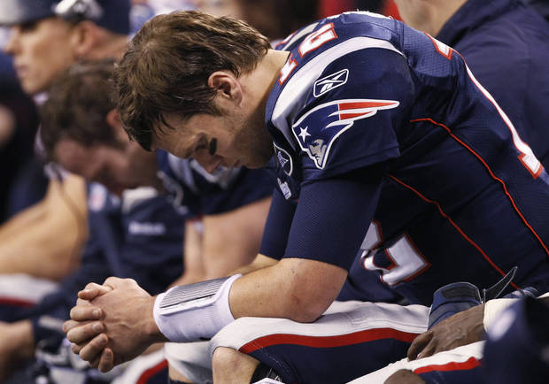 New England Patriots quarterback Tom Brady sits on the bench during the second half of the NFL Super Bowl XLVI football game against the New York Giants, Sunday, Feb. 5, 2012, in Indianapolis. (AP Photo/Paul Sancya)  ORG XMIT: SB445