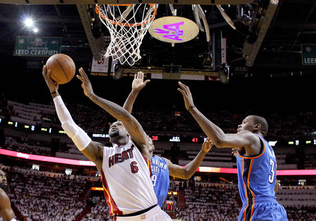 Miami's LeBron James (6) shoots as Oklahoma City's Kevin Durant (35) defends during Game 4 of the NBA Finals between the Oklahoma City Thunder and the Miami Heat at American Airlines Arena, Tuesday, June 19, 2012. Photo by Bryan Terry, The Oklahoman