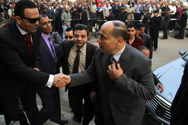 "Newly appointed Egyptian prosecutor general, Talaat Abdullah, arrives for work on his first day in office after being appointed by President Mohammed Morsi in sweeping edicts announced Thursday temporarily giving Morsi near-absolute power over the executive, judicial and legislative branches of government, in Cairo, Egypt, Saturday, Nov. 24, 2012. Morsi fired the controversial former prosecutor general and created ""revolutionary"" judicial bodies to put Mubarak and some of his top aides on trial a second time for the killings of protesters playing to widespread discontent with the judiciary. (AP Photo/Mohammed Abu Zeid)"