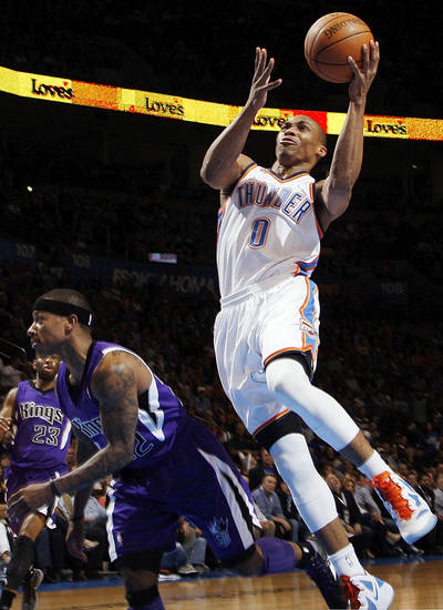 Oklahoma City's Russell Westbrook (0) takes the ball to the hoop over Sacramento's Isaiah Thomas (22) during the NBA basketball game between the Oklahoma City Thunder and the Sacramento Kings at Chesapeake Energy Arena in Oklahoma City, Friday, April 13, 2012. Photo by Nate Billings, The Oklahoman