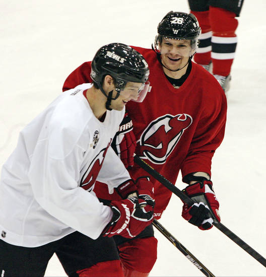New Jersey Devils' Travis Zajac and Patrick Elias skate during NHL hockey practice, Sunday, Jan. 13, 2013, in Newark, N.J. (AP Photo/The Record of Bergen County, Chris Pedota) ONLINE OUT; MAGS OUT; TV OUT; INTERNET OUT;  NO ARCHIVING; MANDATORY CREDIT