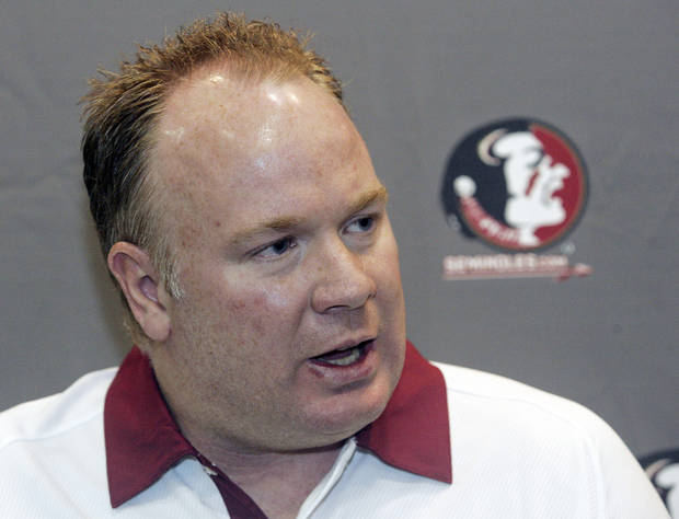 FILE - In this Aug. 12, 2012, file photo, Florida State defensive coordinator Mark Stoops is interviewed during the Seminoles' football media day in Tallahassee, Fla. Kentucky has hired Florida State defensive coordinator Mark Stoops as its new football coach. The university announced Tuesday, Nov. 27, 2012 that Stoops will replace Joker Phillips, who was fired on Nov. 4.  (AP Photo/Phil Sears, File) ORG XMIT: NY162