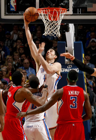 Oklahoma City's Nick Collison (4) goes to the basket during the NBA basketball game between the Oklahoma City Thunder and the Los Angeles at the Oklahoma City Arena, Wednesday, April 6, 2011. Photo by Bryan Terry, The Oklahoman