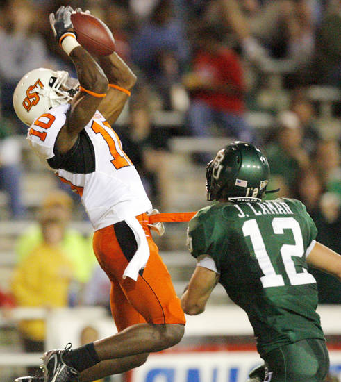 OSU's Tommy Devereaux (10) catches a touchdown pass over Baylor's Jake La Mar (12) in the first half during the college football game between Oklahoma State University and Baylor University at Floyd Casey Stadium in Waco, Texas, Saturday, Nov. 17, 2007. BY MATT STRASEN, THE OKLAHOMAN
