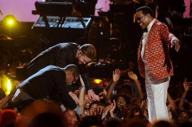 From left, Pharrell Williams, Justin Timberlake and Charlie Wilson are shown onstage at the BET Awards at the Nokia Theatre on Sunday, June 30, 2013, in Los Angeles. (AP)