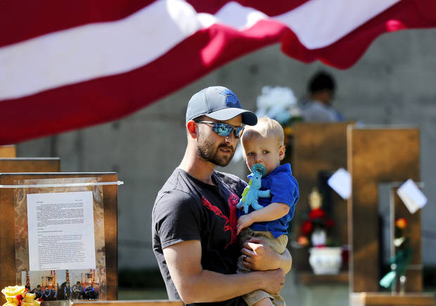Cory Shepherd holds his 17 months-old son, Corbin, as he walks among the Field of Empty Chairs after the 19th anniversary Remembrance Ceremony at the Oklahoma City National Memorial Saturday morning, April 19, 2014, to honor the memory of the 168 victims killed in the 1995 bombing of the Murrah Federal Building. Shepherd, of Newcastle, came to the ceremony with his wife, whose aunt, Kathy Finley, was killed in the Federal Employees Credit Union at the time of the explosion.   Photo by Jim Beckel, The Oklahoman