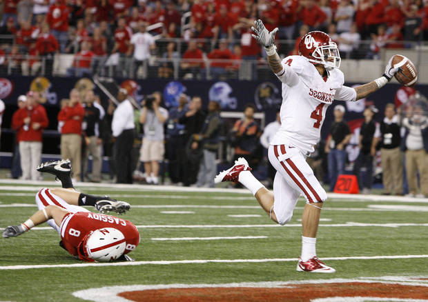 OU's Kenny Stills scores a touchdown in front of Nebraska's Austin Cassidy during the Big 12 football championship game between the University of Oklahoma Sooners (OU) and the University of Nebraska Cornhuskers (NU) at Cowboys Stadium on Saturday, Dec. 4, 2010, in Arlington, Texas.  Photo by Bryan Terry, The Oklahoman