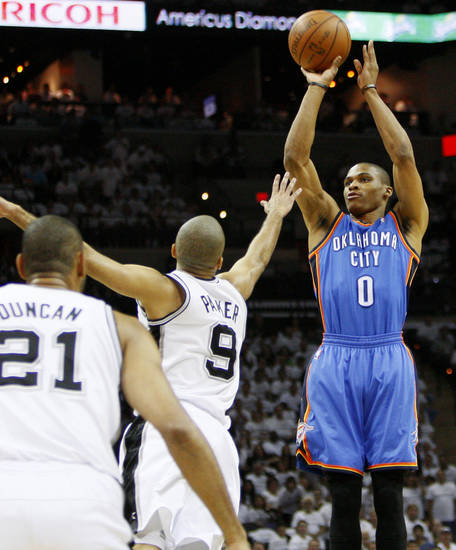 Oklahoma City's Russell Westbrook (0) shoots over San Antonio's Tony Parker (9) as Tim Duncan (21) looks on during Game 5 of the Western Conference Finals between the Oklahoma City Thunder and the San Antonio Spurs in the NBA basketball playoffs at the AT&T Center in San Antonio, Monday, June 4, 2012. Photo by Nate Billings, The Oklahoman