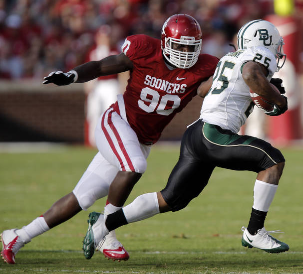 Oklahoma&#039;s David King (90) chases down Baylor&#039;s Lache Seastrunk (25) during the college football game between the University of Oklahoma Sooners (OU) and Baylor University Bears (BU) at Gaylord Family - Oklahoma Memorial Stadium on Saturday, Nov. 10, 2012, in Norman, Okla.  Photo by Chris Landsberger, The Oklahoman