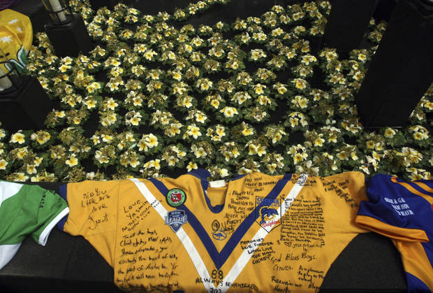 Jerseys worn by victims of the of the 2002 Bali bombings lay at a memorial site during a memorial service to mark the 10th anniversary of the terrorists attacks in Kuta, in Jimbaran, Bali, Indonesia, Friday, Oct. 12, 2012. A decade after twin bombs killed scores of tourists partying at two beachfront nightclubs on Indonesia's resort island of Bali, survivors and victims' families on Friday braved a fresh terrorism threat to remember those lost to the tragedy. (AP Photo/Firdia Lisnawati)