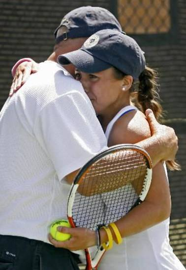 One of the sights to remember at the state tennis tournament as father (Dick Villaflor) and daughter (Carissa) embrace after Carissa's 3rd title.