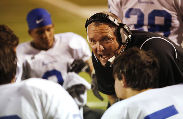 GHS head coach Rafe Watkins talks with his players during a time out during the high school football game between Guthrie at Carl Albert in Midwest City, Friday, October 11, 2013.  Photo by Doug Hoke, The Oklahoman