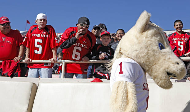 Texas Tech fans yell at OU mascot Sooner during the college football game between the University of Oklahoma Sooners (OU) and Texas Tech University Red Raiders (TTU ) at Jones AT&T Stadium in Lubbock, Texas, Saturday, Nov. 21, 2009. Photo by Bryan Terry, The Oklahoman