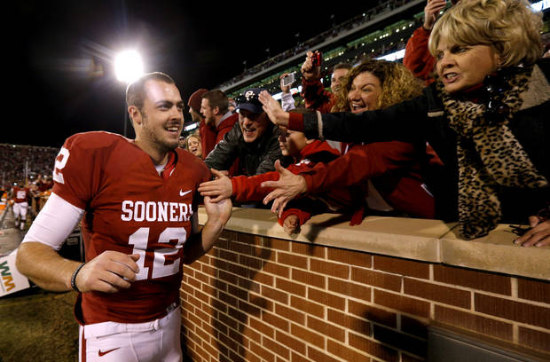 Oklahoma's Landry Jones (12) celebrates with fans after the Bedlam college football game between the University of Oklahoma Sooners (OU) and the Oklahoma State University Cowboys (OSU) at Gaylord Family-Oklahoma Memorial Stadium in Norman, Okla., Saturday, Nov. 24, 2012. Oklahoma won 51-48. Photo by Bryan Terry, The Oklahoman