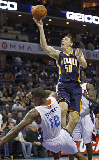 Indiana Pacers' Tyler Hansbrough (50) knocks down Charlotte Bobcats' Tyrus Thomas (12) as he drives to the basket during the first half of an NBA basketball game in Charlotte, N.C., Friday, Nov. 2, 2012. Thomas was charged with a foul on the play. (AP Photo/Chuck Burton)