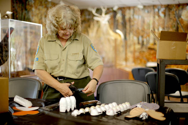 Park Naturalist Kathy Furneaux prepares  for a caterpillar and butterfly craft session for kids at Discovery Cove Nature Center at Lake Thunderbird in Norman, Okla., Saturday, July 31, 2010.  Photo by Bryan Terry, The Oklahoman