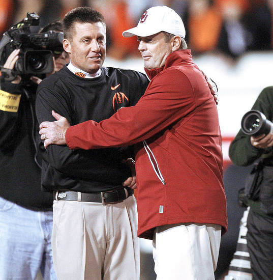 Oklahoma State coach Mike Gundy and Oklahoma coach Bob Stoops meet before the Bedlam college football game between the Oklahoma State University Cowboys (OSU) and the University of Oklahoma Sooners (OU) at Boone Pickens Stadium in Stillwater, Okla., Saturday, Dec. 3, 2011. Photo by Bryan Terry, The Oklahoman <strong>BRYAN TERRY - BRYAN TERRY</strong>