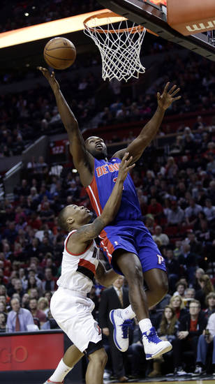 Detroit Pistons guard Rodney Stuckey, right, is fouled by Portland Trail Blazers guard Damian Lillard while going to the hoop during the first quarter of an NBA basketball game in Portland, Ore., Saturday, March 16, 2013. (AP Photo/Don Ryan)