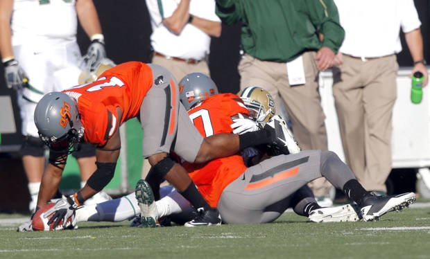 Oklahoma State's Brodrick Brown (19) recovers a fumble during the third quarter of a college football game between the Oklahoma State University Cowboys (OSU) and the Baylor University Bears (BU) at Boone Pickens Stadium in Stillwater, Okla., Saturday, Oct. 29, 2011. Photo by Sarah Phipps, The Oklahoman