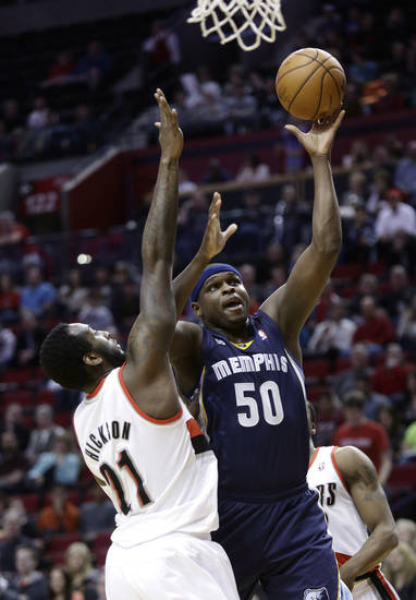 Memphis Grizzlies forward Zach Randolph, right, shoots against Portland Trail Blazers forward J.J. Hickson during the first quarter of an NBA basketball game in Portland, Ore., Wednesday, April 3, 2013.(AP Photo/Don Ryan)