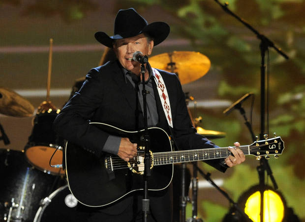 Singer George Strait performs at the 48th Annual Academy of Country Music Awards at the MGM Grand Garden Arena in Las Vegas on Sunday, April 7, 2013. (Photo by Chris Pizzello/Invision/AP) ORG XMIT: NVPM213