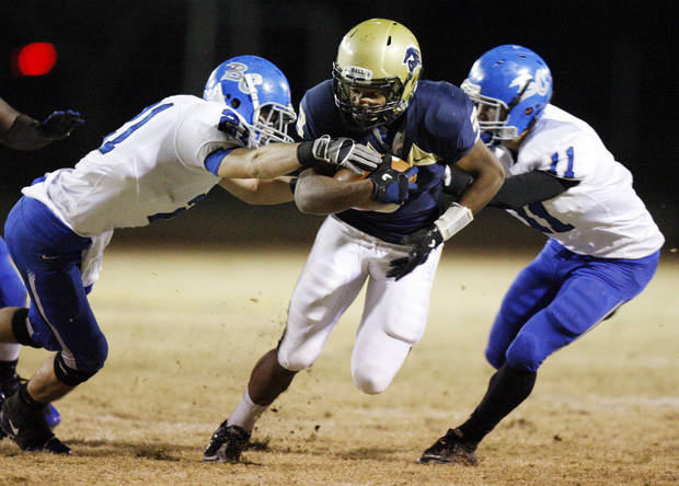 Heritage Hall's Sterling Shepard (3) breaks away from Joshua Pershica (21), left, and Caden Locke (11) of Bridge Creek as Shepard takes a reception for a touchdown in the second quarter during the high school football playoff game between Bridge Creek and Heritage Hall at Heritage Hall School in Oklahoma City, Friday, Nov. 19, 2010. Photo by Nate Billings, The Oklahoman