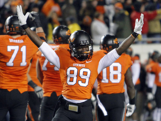 Oklahoma State's Nigel Nicholas (89) celebrates the 44-10 win over Oklahoma during the Bedlam college football game between the Oklahoma State University Cowboys (OSU) and the University of Oklahoma Sooners (OU) at Boone Pickens Stadium in Stillwater, Okla., Saturday, Dec. 3, 2011. Photo by Chris Landsberger, The Oklahoman