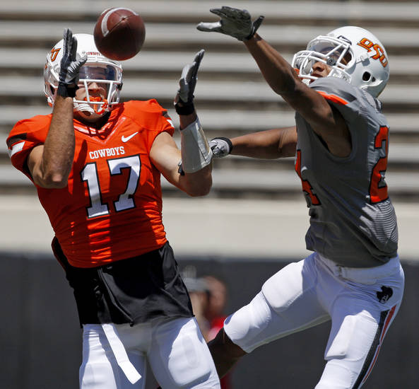 OSU's Charlie Moore catches a touchdown pass in front of OSU's Miketavius Jones during Oklahoma State's spring football game at Boone Pickens Stadium in Stillwater, Okla., Saturday, April 21, 2012. Photo by Bryan Terry, The Oklahoman