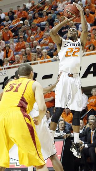 Oklahoma State Cowboys' Markel Brown (22) shoots over Iowa State Cyclones' Georges Niang (31) during the college basketball game between the Oklahoma State University Cowboys (OSU) and the Iowa State University Cyclones (ISU) at Gallagher-Iba Arena on Wednesday, Jan. 30, 2013, in Stillwater, Okla.  Photo by Chris Landsberger, The Oklahoman