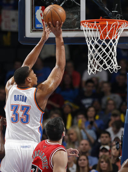 Oklahoma City's Daniel Orton (33) shoots over Chicago's Vladimir Radmanovic (77) during the NBA game between the Oklahoma City Thunder and the Chicago Bulls at Chesapeake Energy Arena in Oklahoma City, Sunday, Feb. 24, 2013. Photo by Sarah Phipps, The Oklahoman