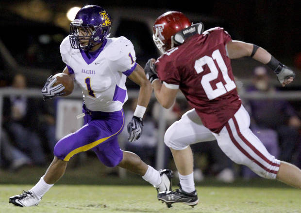 Anadarko's Sheldon Wilson gets by Tuttle's Toby Coats during the high school football game between Tuttle and Anadarko, Friday, Oct. 29, 2010, in Tuttle, Okla. Photo by Sarah Phipps, The Oklahoman