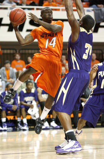 OSU's Ray Penn passes the ball around Prairie View A&M's Brandon Webb during the college basketball game between Oklahoma State University and Prairie View A&M at Gallagher-Iba Arena in Stillwater, Okla., Tuesday, November 24, 2009. Photo by Bryan Terry, The Oklahoman