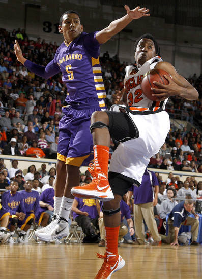 Najee Cox comes down with a rebound beside Anadarko's Kyle Bert during the Class 4A boys high school state basketball championship game at State Fair Arena in Oklahoma City, Saturday, March 10, 2012. Photo by Bryan Terry, The Oklahoman