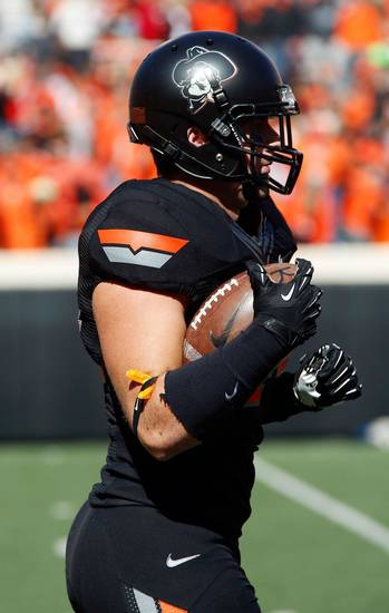 All-Black jersey combo for Oklahoma State today, complete with the Phantom Pete helmet logo