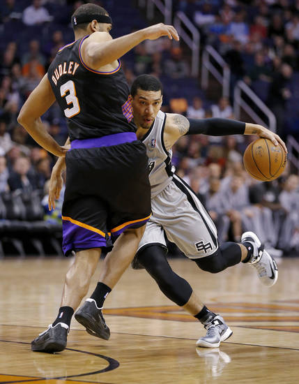San Antonio Spurs' Danny Green collides with Phoenix Suns' Jared Dudley (3) during the first half of an NBA basketball game, Sunday, Feb. 24, 2013, in Phoenix. (AP Photo/Matt York)