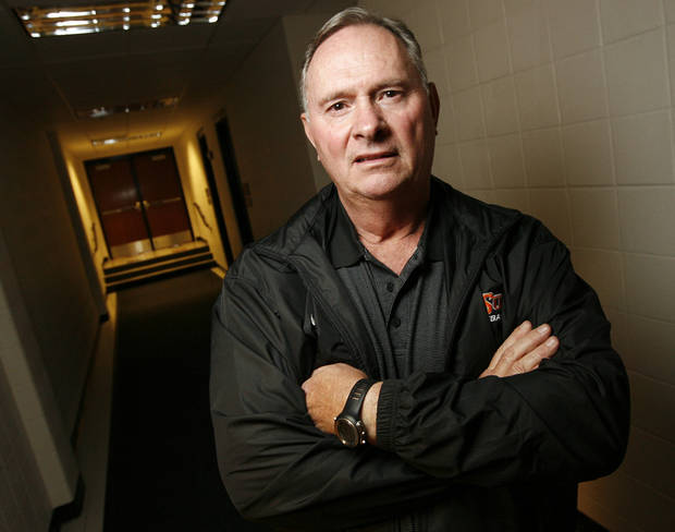 New OSU college football defensive coordinator Bill Young poses for a photo in a hall inside Gallagher-Iba Arena on the campus of Oklahoma State University in Stillwater, Okla., Friday, January 23, 2009. BY NATE BILLINGS, THE OKLAHOMAN ORG XMIT: KOD