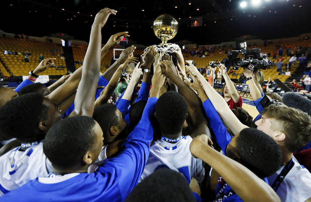 The Tulsa Memorial Chargers raise the gold ball after the Class 5A boys championship high school basketball game in the state tournament at the Mabee Center in Tulsa, Okla., Saturday, March 9, 2013. Tulsa Memorial defeated Bishop McGuinness, 59-42.  Photo by Nate Billings, The Oklahoman
