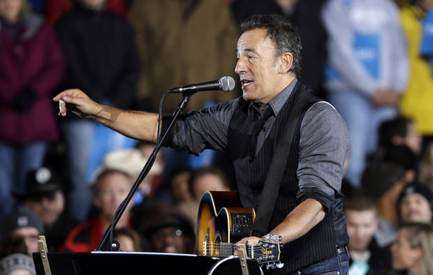Singer Bruce Springsteen performs prior to President Barack Obama taking the stage at his final campaign stop on the evening before the 2012 election, Monday, Nov. 5, 2012, in Des Moines, Iowa. (AP Photo/Charlie Neibergall)