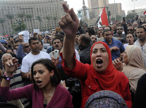 Egyptian protesters opposed to president Mohammed Morsi chant slogans in Tahrir Square in Cairo, Egypt, Friday, Nov. 23, 2012. Opponents and supporters of Mohammed Morsi clashed across Egypt on Friday, the day after the president granted himself sweeping new powers that critics fear can allow him to be a virtual dictator.(AP Photo/Mohammed Asad)