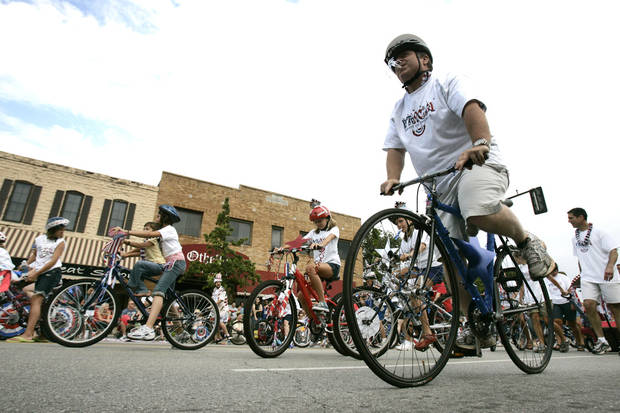 Bicyclers ride down Broadway in the LibertyFest Parade in downtown Edmond, OK, Saturday, July 4, 2009. By Paul Hellstern, The Oklahoman