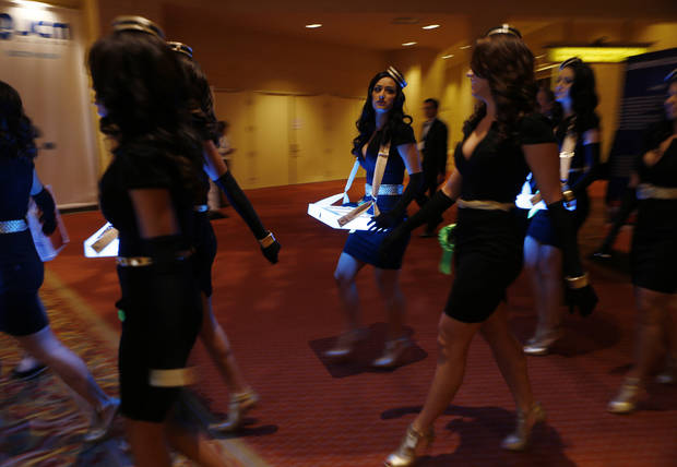 Electronic cigarette models walk the halls of Global Gaming Expo on Wednesday, Oct. 3, 2012, in Las Vegas. (AP Photo/Isaac Brekken)