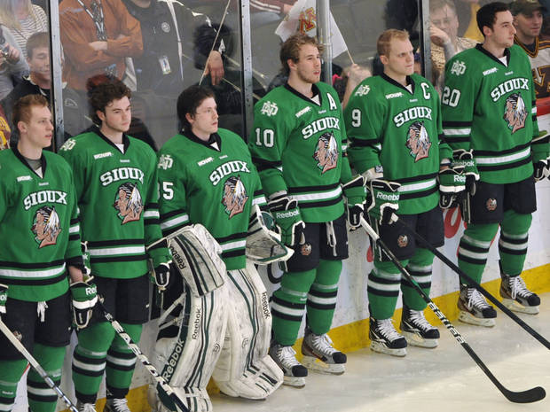 "FILE - In this March 16, 2012, file photo, North Dakota hockey players wearing Fighting Sioux logo jerseys that were replaced by new jerseys during WCHA Final Five Championships in St. Paul, Minn. The decades-old debate over whether to keep the University of North Dakota's Fighting Sioux nickname finally seemed to come to an end as 68 percent of voters in the June primary agreed it was time to drop the nickname deemed ""hostile and abusive"" by the NCAA. In what appears to be a final nail in the nickname's casket, a group pushing a state constitutional amendment to save it missed a December deadline to resurrect the issue. (AP Photo/Jim Mone, File)"
