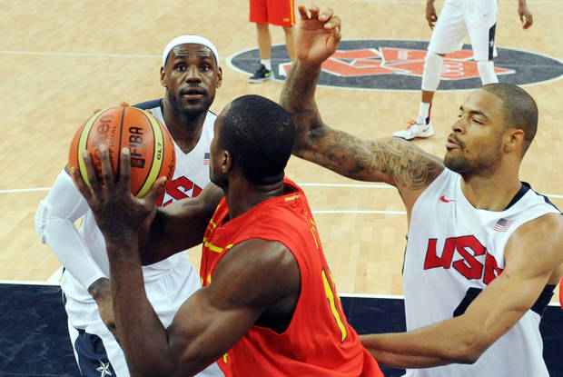 United States' LeBron James, left, and Tyson Chandler, right, pressure Spain's Serge Ibaka during the men's gold medal basketball game at the 2012 Summer Olympics  in London on Sunday, Aug. 12, 2012. (AP Photo/Mark Ralston, Pool)