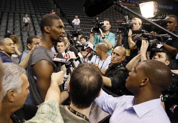 Miami's Chris Bosh is surrounded by reporters and photographers during media and practice day for the NBA Finals between the Oklahoma City Thunder and the Miami Heat at the Chesapeake Energy Arena in Oklahoma City, Monday, June 11, 2012. Photo by Nate Billings, The Oklahoman