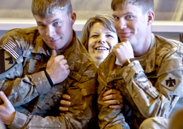 Kristy Brock poses for photos with her two sons Jake Farrow, left, and Justin during the return ceremony for more than 200 National Guard 45th Infantry Brigade Combat Team troops at the National Guard Base on Monday, March 12, 2012, in Oklahoma City, Oklahoma.  Photo by Chris Landsberger, The Oklahoman