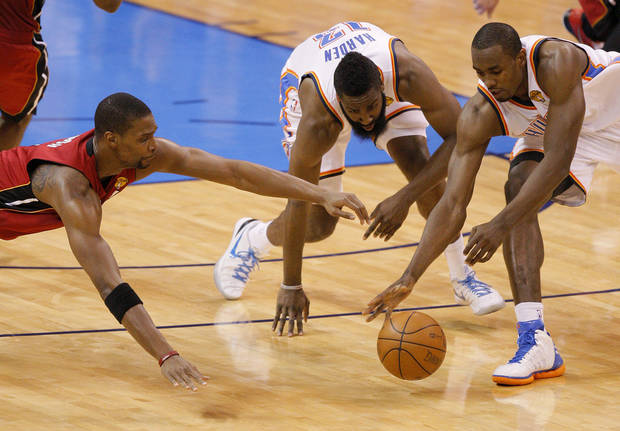 Miami's Chris Bosh (1) goes for the ball beside Oklahoma City 's James Harden (13) and Serge Ibaka (9) during Game 1 of the NBA Finals between the Oklahoma City Thunder and the Miami Heat at Chesapeake Energy Arena in Oklahoma City, Tuesday, June 12, 2012. Photo by Nate Billings, The Oklahoman