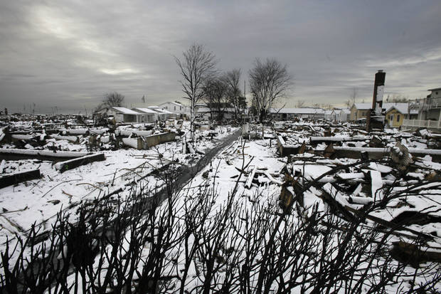 The fire-scorched landscape of Breezy Point is shown after a Nor'easter snow, Thursday, Nov. 8, 2012 in New York.  The beachfront neighborhood was devastated during Superstorm Sandy when a fire pushed by the raging winds destroyed many homes.  (AP Photo/Mark Lennihan) ORG XMIT: NYML104