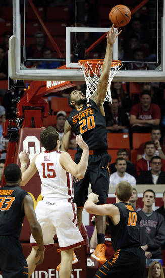 Cowboy's Michael Cobbins (20) blocks a shot as the University of Oklahoma Sooners (OU) play the Oklahoma State Cowboys (OSU) in NCAA, men's college basketball at The Lloyd Noble Center on Saturday, Jan. 12, 2013  in Norman, Okla. Photo by Steve Sisney, The Oklahoman